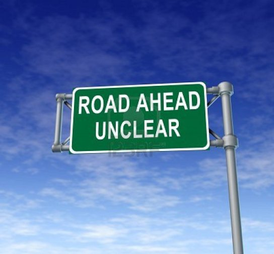 11405182-road-ahead-unclear-green-freeway-sign-representing-uncertainty-in-financial-business